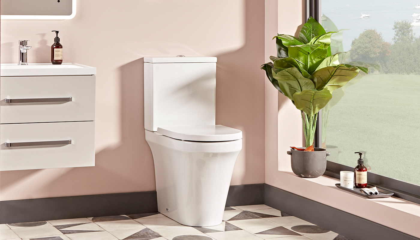 What is the difference between a standard and a comfort height toilet?